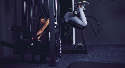 Young woman doing legs exercise at fitness centre
