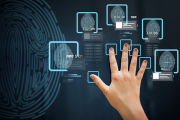 future technology, security and identification concept - hand using interactive panel touch screen...
