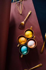Luxury easter concept, colored golden egg with cutlery