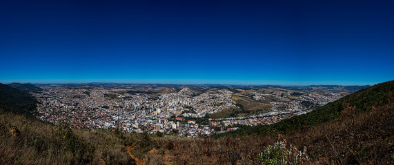 Panoramic photo of the city Poços de Caldas, Minas Gerais - Brazil, from the top of the mountain with blue sky on sunny day