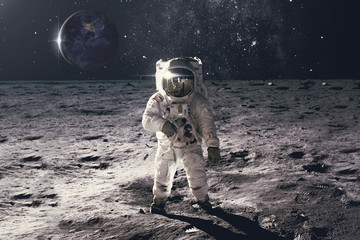 Spoed Fotobehang Heelal Astronaut on rock surface with space background. Elements of this image furnished by NASA