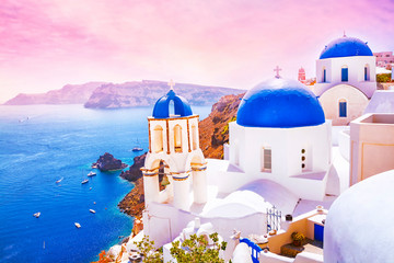 Spoed Foto op Canvas Santorini Beautiful sunset in the fabulous village of Oia with traditional white houses and blue domes of the church in Santorini, Greece
