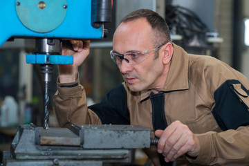 welder drilling a metal board
