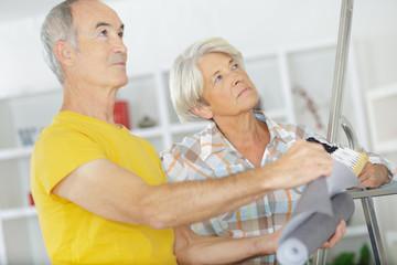 an elderly couple during diy
