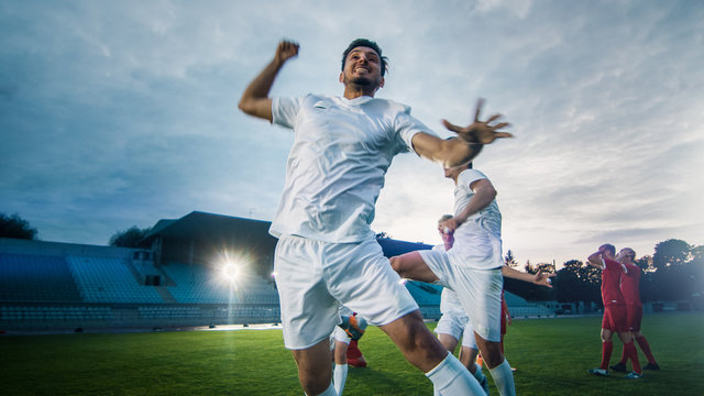 Portrait Shot of Captain of the Soccer Team Celebrates Awesome Victory with His Team, Doing YES Gesture. Team of Celebrate Winning Championship.
