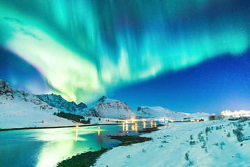 Lofoten Islands, Norway. Amazing winter landscape - Aurora Borealis natural wonder making dramatic night sky on March. Northern lights over Polar Circle.