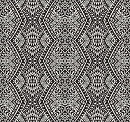 Vector abstract seamless pattern from black, grey and light beige ikat geometrical shapes, rhombus, triangles, Maori ornaments, waves, stripes. Textile print, Wrapping paper, wallpaper. Batik paint