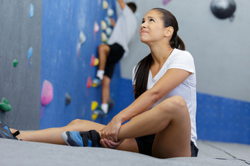 female athlete suffering form ankle injury