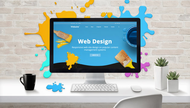 Web design concept. Modern web site on computer display surrounded by brush color drops.