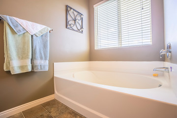 Home bathroom interior with bathtub in front of the window with blinds Wall mural