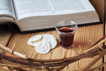 Holy Communion, a Cup of Wine and Bread with a Jesus Crown Thorn and Holy Bible