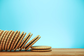 Сookie sandwich on ared wooden table, blue background.