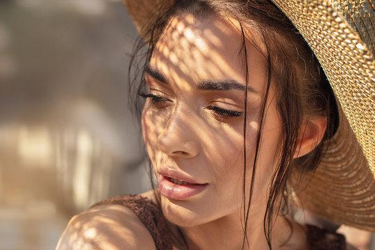 Portrait of beauty girl in summer hat.