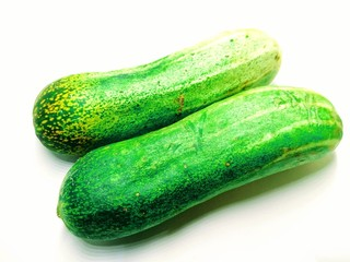 A picture of fresh cucumbers isolated on white background