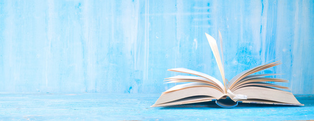 open book, close up on blue grungy background,reading, education, literature,learning, good copy...