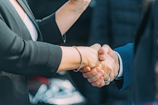 Business handshake. Business woman shaking hands with businessman