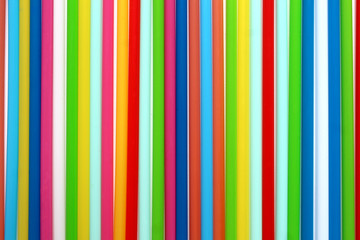 Texture of colorful plastic cocktail tubes close up