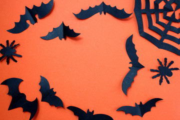 Halloween holiday concept with paper black bats.