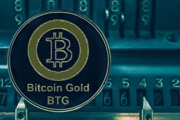 Coin Bitcoin gold btg against the numbers of the arithmometer. Crypto com chain
