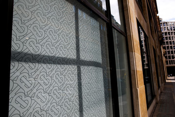 The Burberry logo is pictured in a window of a Burberry office in central London