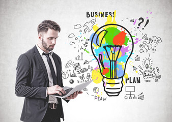 Serious businessman with laptop, business idea