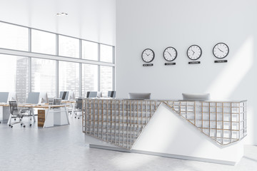 Reception desk with clocks in office corner