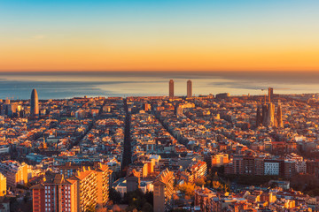 High angle panoramic view over Barcelona Spain and Mediterranean Sea around sunset