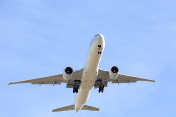 commercial airliner flying overhead