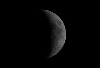 Great waxing crescent Moon phase, isolated in the black space, with its craters.