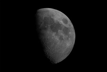 Waxing gibbous Moon phase, isolated in the black space, with craters in detail on its surface.
