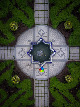 Aerial view of fountain in hedge maze