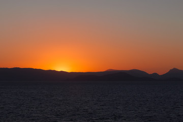 Beautiful colorful sky and setting sun on the islands of the Saronic Gulf