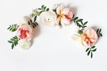 Printed kitchen splashbacks Floral Decorative wreath, floral garland, composition with pink English roses, ranunculus and green leaves on white table background. Flower pattern. Flat lay, top view. Wedding, birthday styled stock photo.