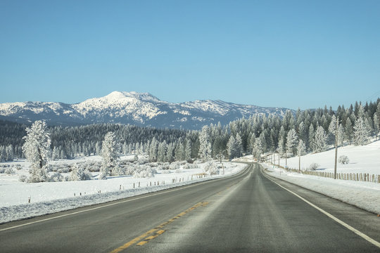 Highway 58 road scene with snowy mountains - Near McCall, Idaho