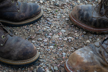 close up of work boots opposite each other on a job site