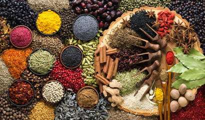 Fototapete - Aromatic herbs and spices background. Seasoning as ingredient for delicious food.