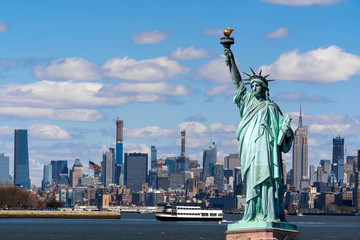 Poster de jardin New York The Statue of Liberty over the Scene of New york cityscape river side which location is lower manhattan,Architecture and building with tourist concept