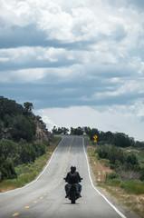 Motorcycle rider on open road - Highway 145, near Naturita - Colorado