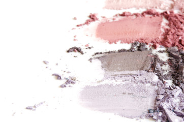 Crushed eyeshadow makeup set isolated on white background. The concept of fashion and beauty...