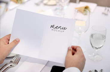 Restaurant Wedding Chilling Out Classy Lifestyle Concept. Restaurant with the menu in hands. Menu mockup.