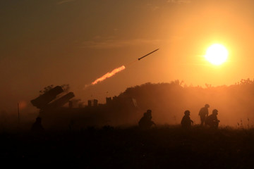 Indonesia's marine soldiers release a shot using a multiple launch rocket the RM-70 during a drill at Banongan beach in Situbondo, East Java province