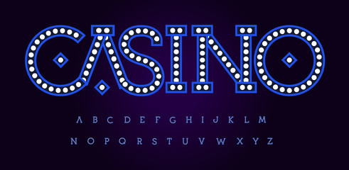 Fototapeta Flashlights letters, night style vector latin alphabet. Font for events, club, casino promotions, logos, banner, monogram and poster. Typography design. Light typescript on black background.