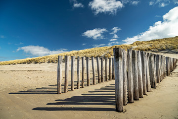 Domburg - Close-Up to Timber Piles  on a sunny Day /Netherlands