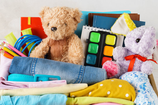 Colorful clothes for children or teenagers, toys and stationery.