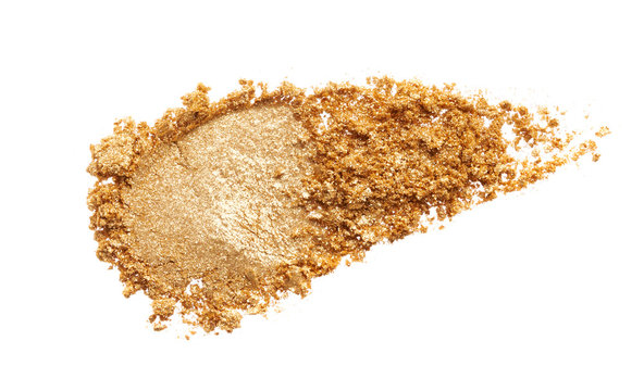Texture of gold eye shadow isolated on white background. Macro texture of broken gold powder