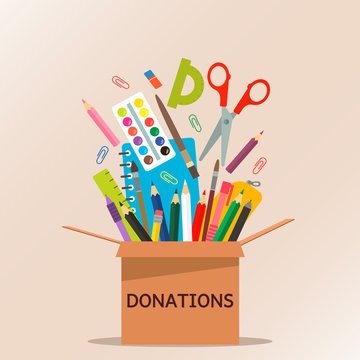 brown cardboard box for donations full of stationery to a school for poor people.