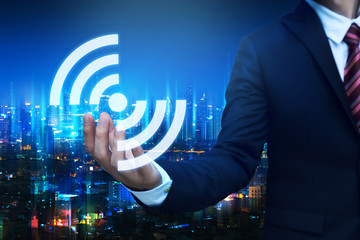 Wall Mural - Business man with wifi network connection concept