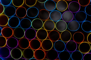 Wall Mural - Abstract composition of colorful plastic straws seen from above, concept accessories to celebrate your party