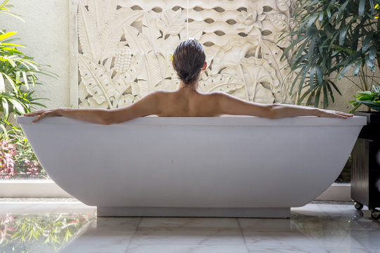 File name:Portrait of a young woman relaxing in the bathtub, organic skin-care at the luxury hotel spa, wellbeing and self-care concept
