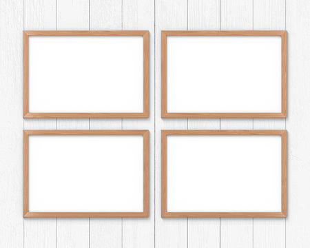 Set of 4 horizontal wooden frames mockup hanging on the wall. Empty base for picture or text. 3D rendering.